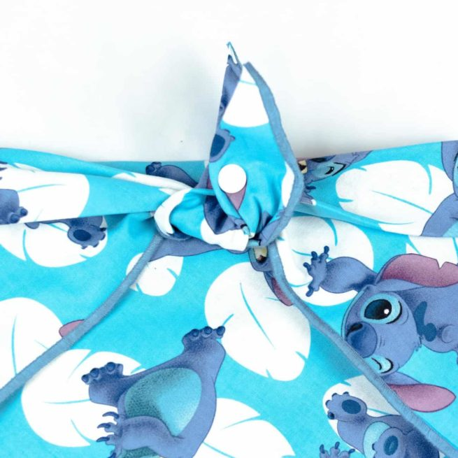 Cartoon Character Stitch with White leaves and blue background dog bandana