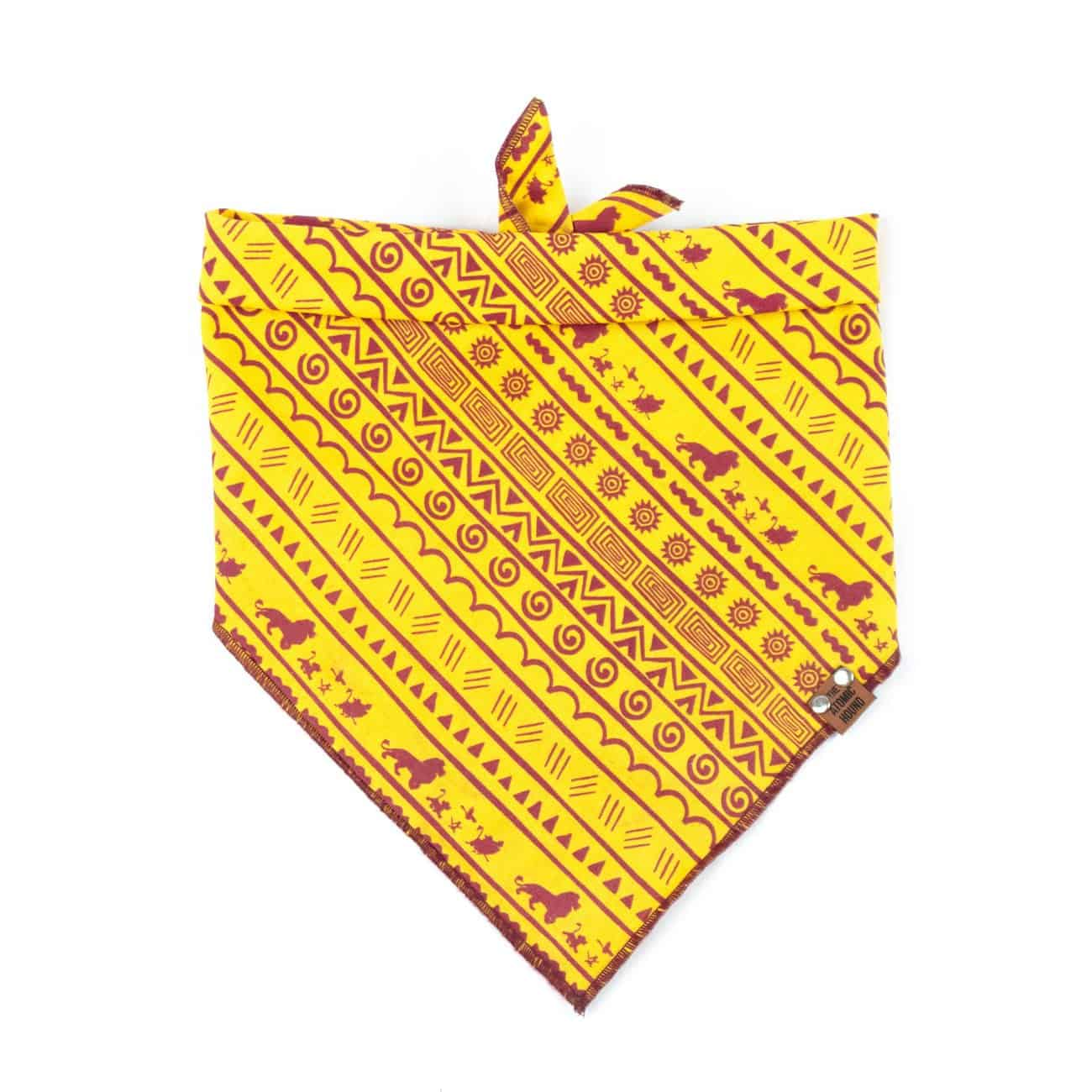 Yellow and maroon dog bandana with Lion King character pattern