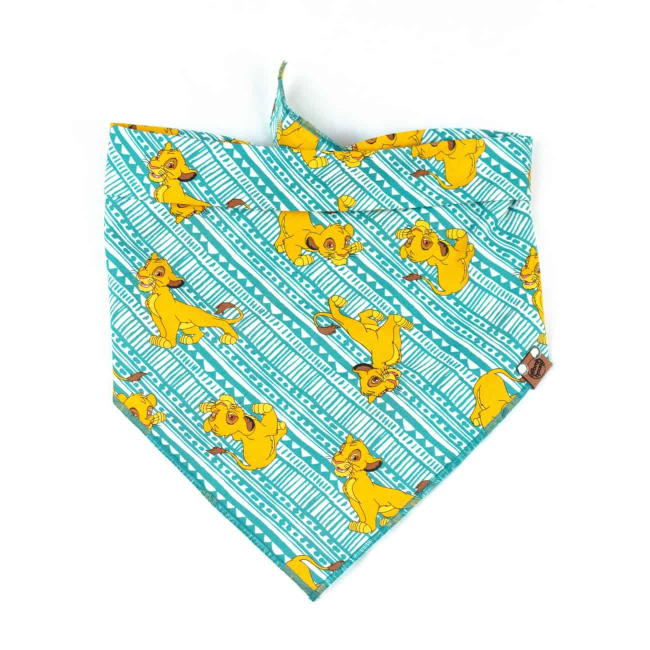 Turquoise and golden cartoon lion dog bandana
