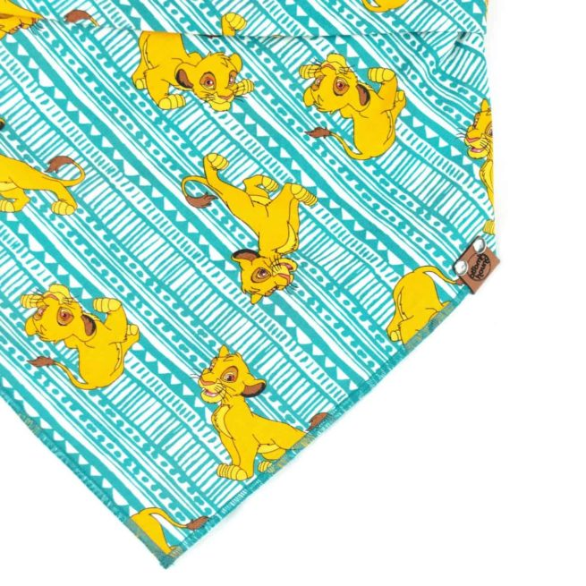 Turquoise Dog Bandana with golden cartoon lions
