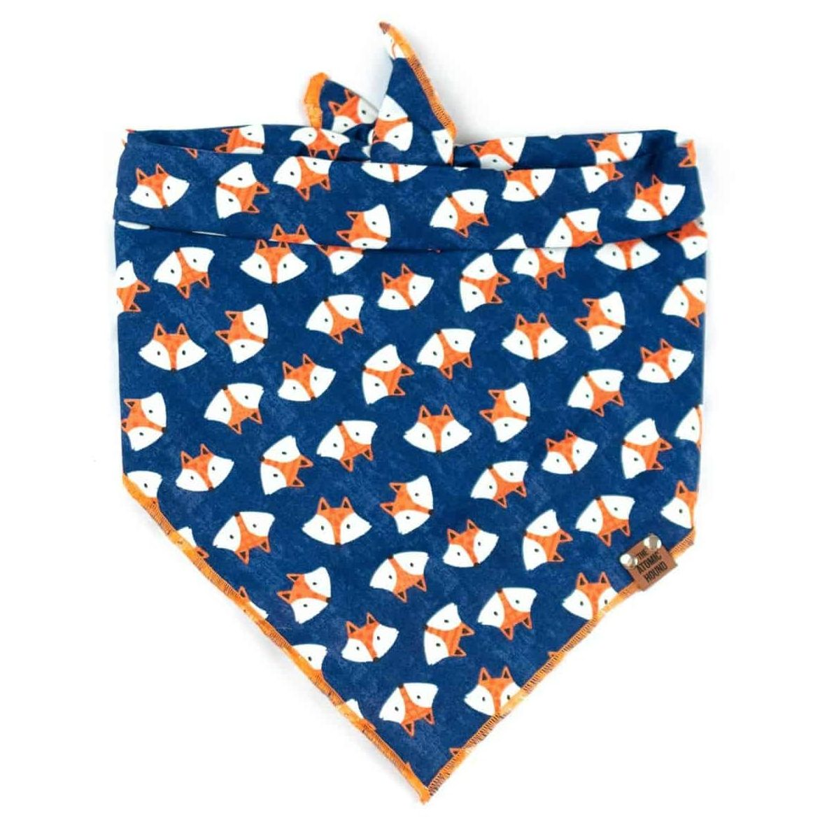 Navy blue dog bandana with orange and white fox print and orange hem