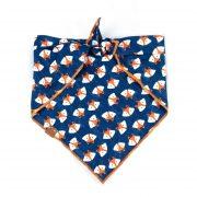 Navy blue dog bandana with orange and white fox print and orange hem