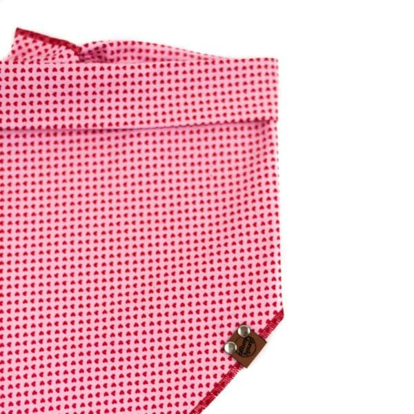 Light pink dog bandana with red mini hearts