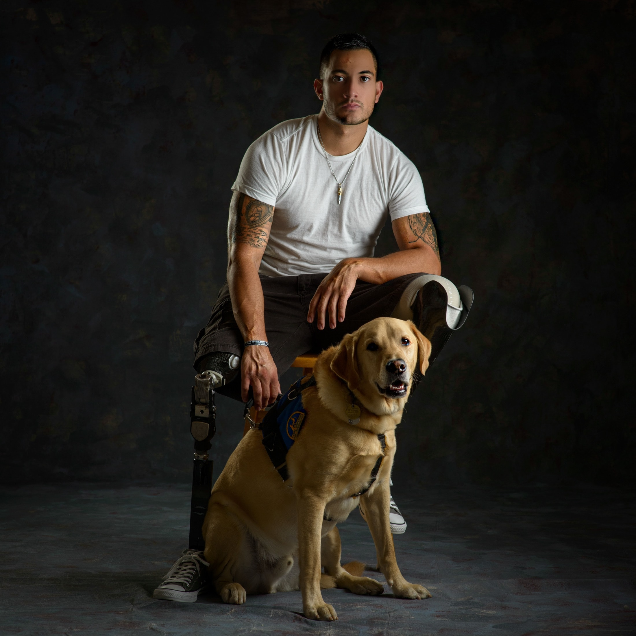 Gabe and Wonka: He's a Marine who was injured during his second deployment to Afghanistan and consequently lost both of his legs. Now Gabe has Service Dog Wonka to help him with daily tasks like retrieving his prosthetic legs from the floor when he's using his wheelchair.