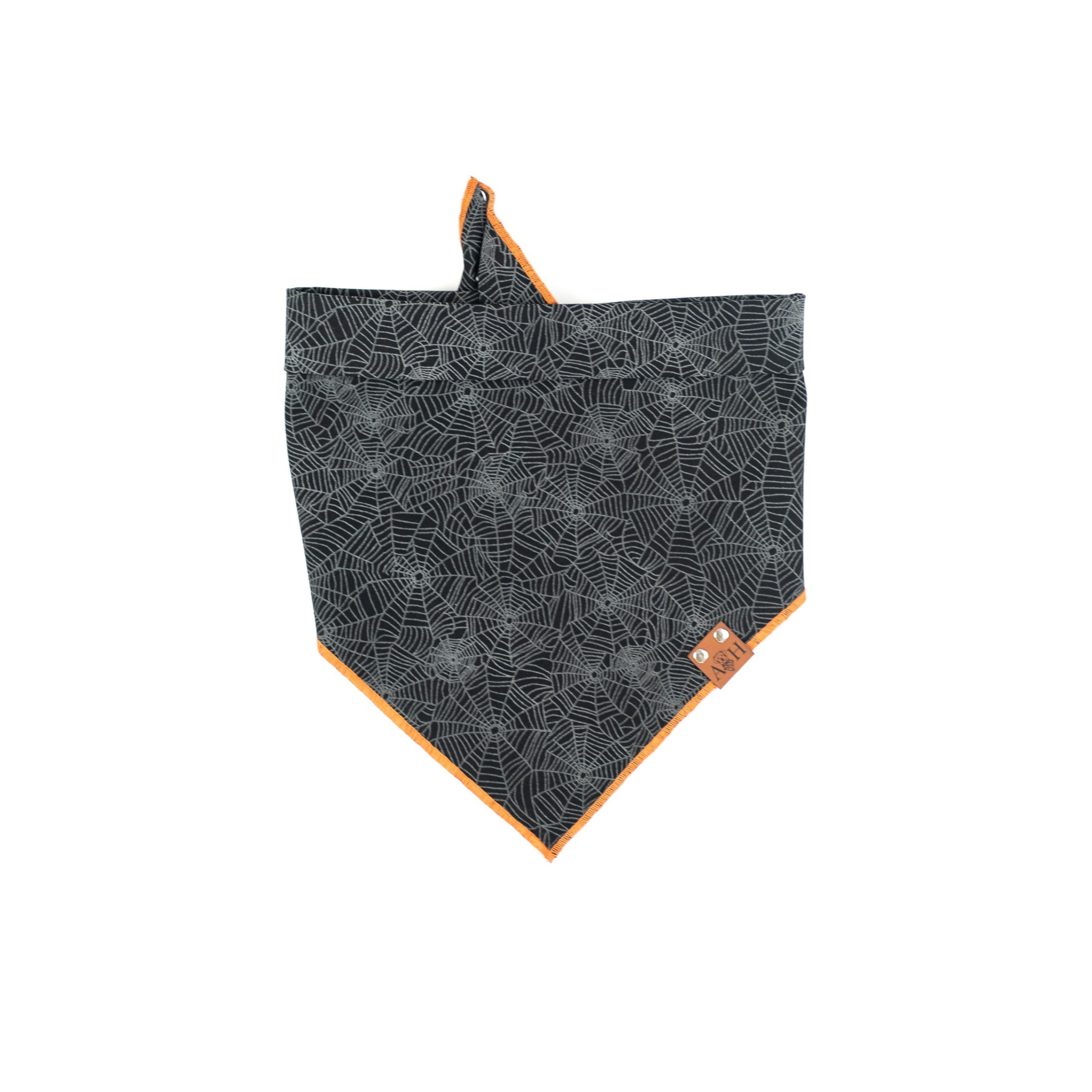 Glow in the dark spider web with orange accent dog bandana
