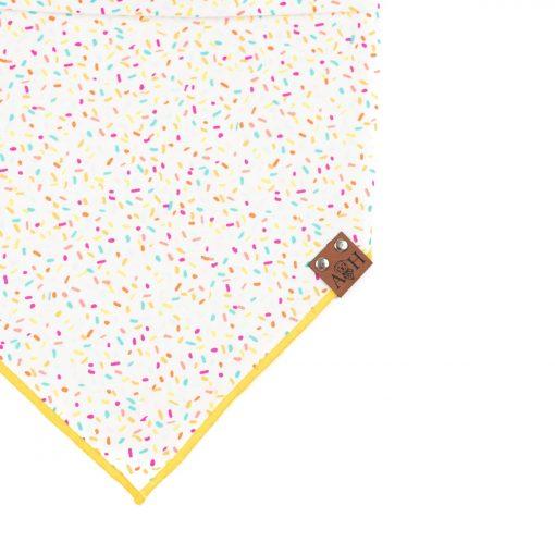 sprinkles dog bandana with a yellow trim