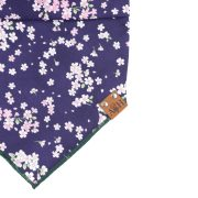 Thalia dog bandana with purple background and pink cherry blossoms